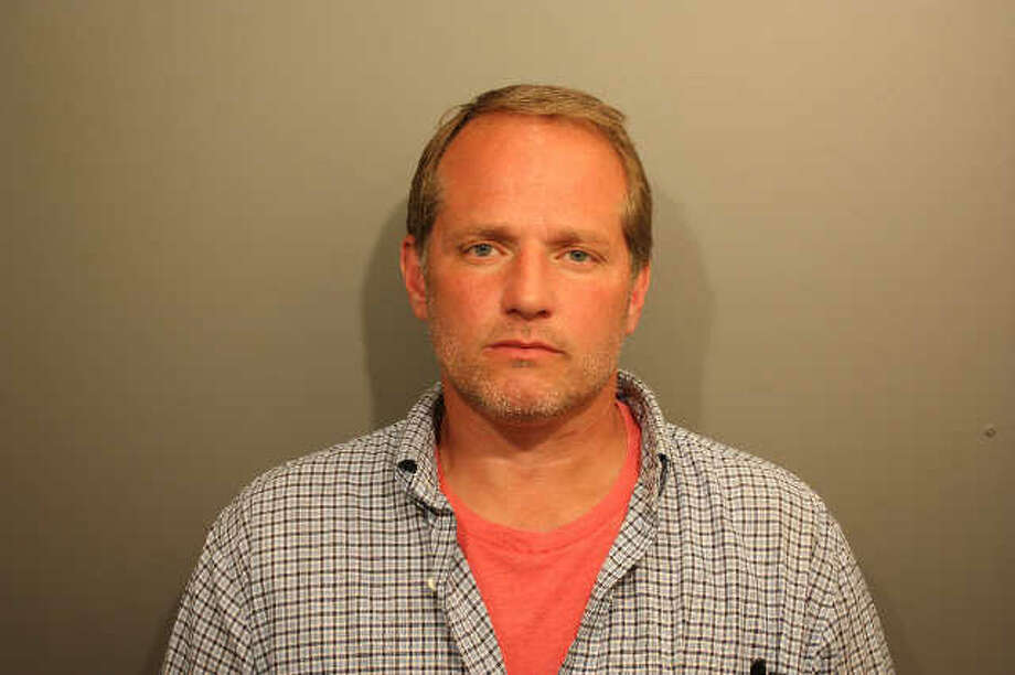 This photo provided by the Wilton Police Department shows Patrick Church. Church, 43, is accused of stealing $900 from a local pet foods store, where he worked as the manager.