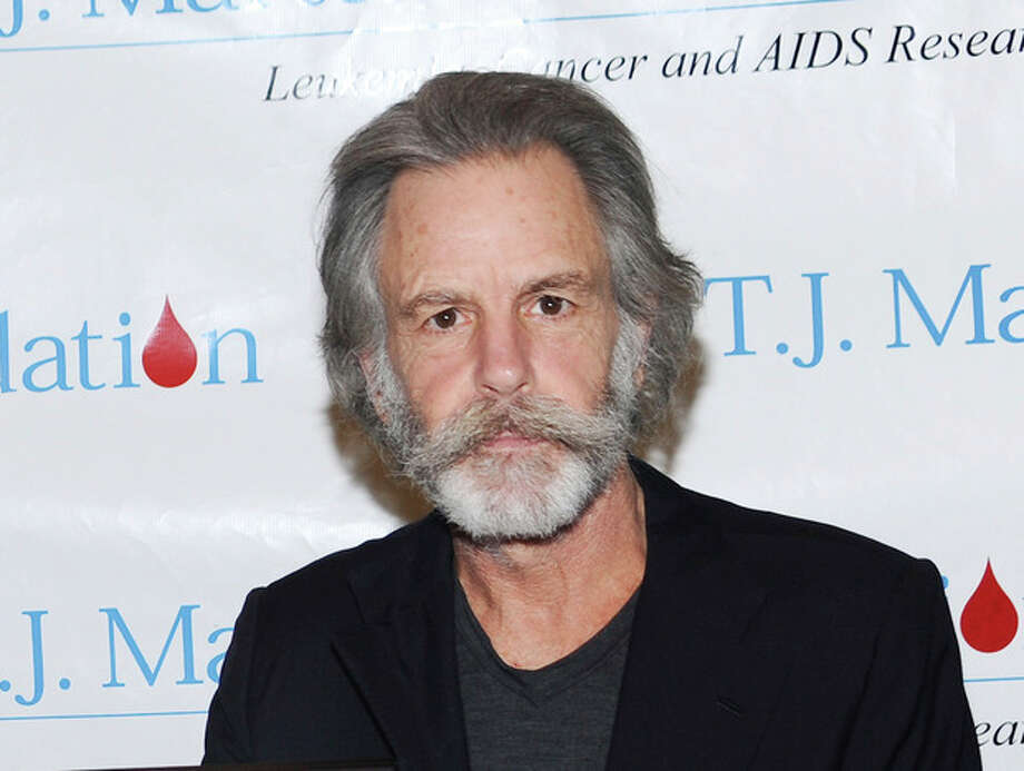 """FILE - This Feb. 24, 2010 file photo shows musician Bob Weir at SIRIUS XM Radio in New York. Weir fell onstage while strumming his guitar at a concert in Port Chester, N.Y. Furthur has cancelled a tour date after guitarist Bob Weir fell onstage at a concert last week. Weir said on his website Tuesday that the band is """"unable to perform for the next several weeks ... due to unforeseen circumstances."""" They were scheduled to play May 9 in Napa, Calif. (AP Photo/Evan Agostini, file) / AGOEV"""