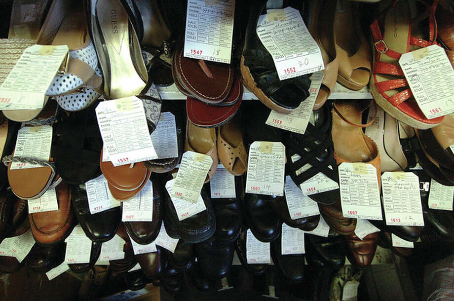 Hour Photo/ Alex von Kleydorff. Shoes ready for pick up at The Wilton Shoemaker / 2012 The Hour Newspapers