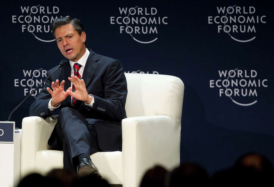 FILE - Mexico's President Enrique Pena Nieto speaks during the inauguration of the World Economic Forum on Latin America in Lima, Peru, in this April 24, 2013 file photo. Mexico is ending the widespread access it gave to U.S. security agencies in the name of fighting drug trafficking and organized crime as the country's new government seeks to change its focus from violence to its emerging economy. The change was confirmed by Mexico's Foreign Ministry on Monday April 29, 2013. (AP Photo/Martin Mejia, File) / AP