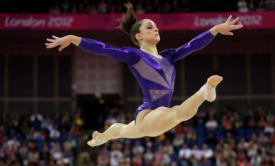 U.S. gymnast Jordyn Wieber performs on the floor during the Artistic Gymnastics women's qualification at the 2012 Summer Olympics, Sunday, July 29, 2012, in London. (AP Photo/Gregory Bull) / AP