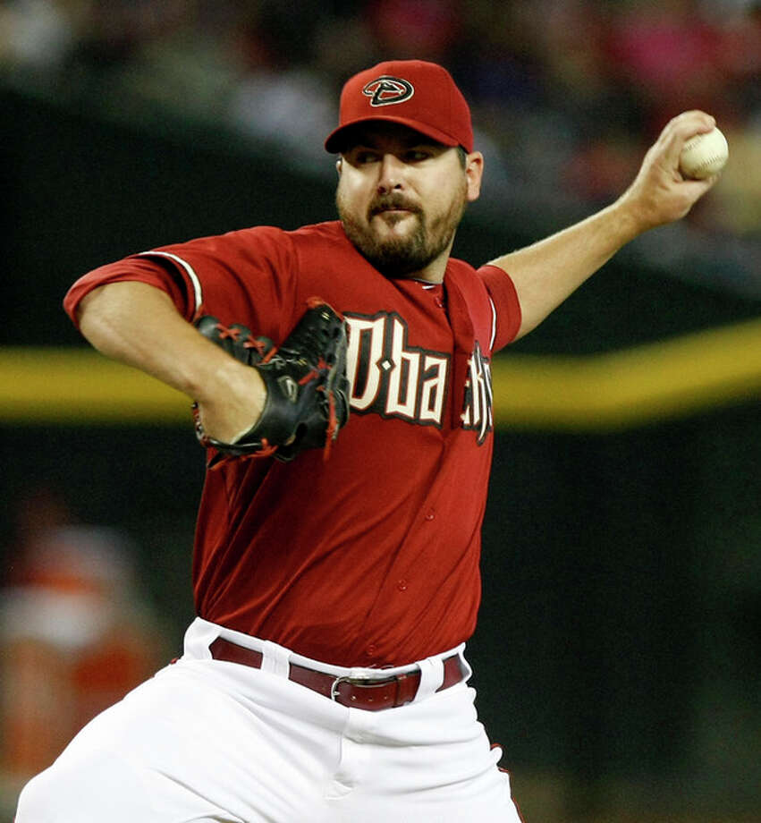 Arizona Diamondbacks pitcher Joe Saunders throws against the New York Mets in the first inning during a baseball game on Sunday, July 29, 2012, in Phoenix. (AP Photo/Rick Scuteri) / FR157181 AP