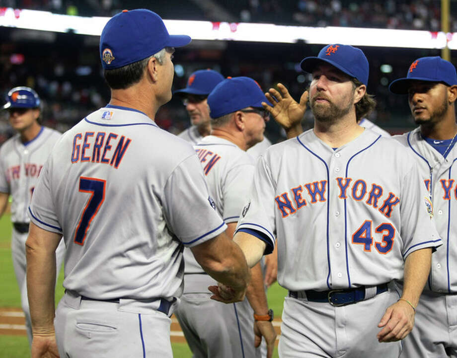 New York Mets R.A. Dickey, right, celelbrates with bench coach Bob Geren after defeating the Arizona Diamondbacks 5-1 during a baseball game on Sunday, July 29, 2012, in Phoenix. (AP Photo/Rick Scuteri) / FR157181 AP