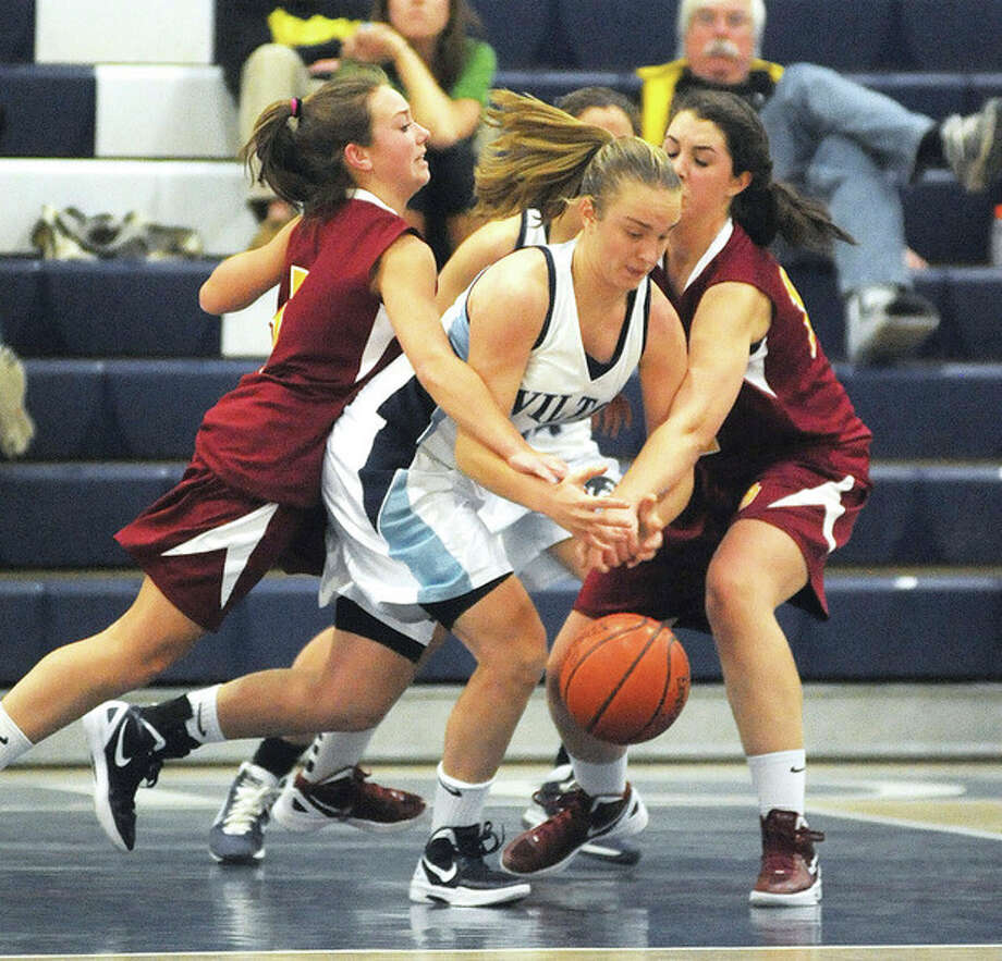Hour photo/John Nash Wilton's Maddy Fulton dribbles out of traffic during the second half of Tuesday's game against St. Joseph. Fulton had 15 points and the Warriors knocked off the previously unbeaten Cadets, 47-28.