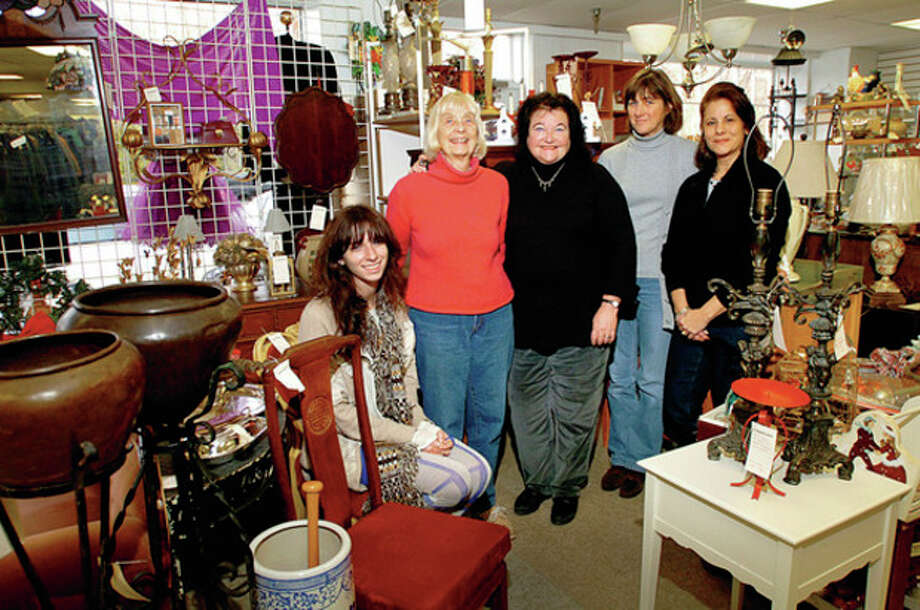 Hour photo / Erik Trautmann From the left, Allison Garvey, Nea Martin, Sharon Sobel, executive director of the Turnover Shop, Macgregor Onderdonk and Barbara Rimalcis in the Turnover Shop. The Turnover Shop thrift store has donated more than a miilion dollars over the past 65 years to the education and wellness of Wilton. This year, it donated its proceeds, $72,000, to the Wilton PTA and Visiting Nurses and Hospice Care of Fairfield County. / (C)2011, The Hour Newspapers, all rights reserved
