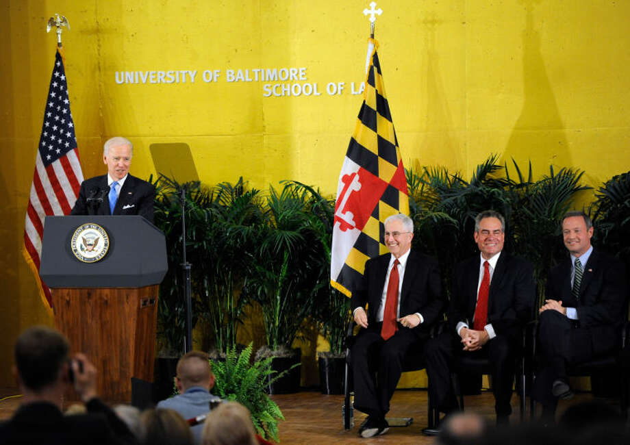 From left, Vice President Joe Biden speaks as Robert L. Bogomolny, president of University of Baltimore, Ronald Weich, University of Baltimore School of Law dean, and Maryland Gov. Martin O'Malley listen during a ceremony to mark the opening of the John and Frances Angelos Law Center at the University of Baltimore Tuesday, April 16, 2013 in Baltimore. Biden's topics included the recent bombing in Boston and gun control. (AP Photo/Steve Ruark)