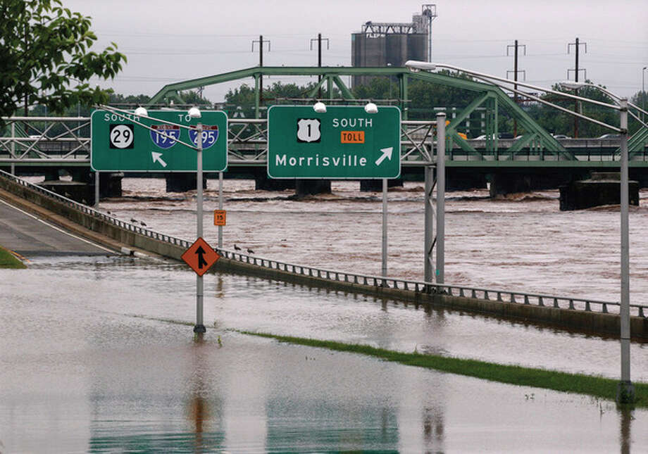 The area's major north-south highway, Route 29, is flooded Thursday, Sept. 8, 2011, in Trenton, N.J., as the Delaware River continues to rise. Remnants from tropical Storm Lee continue to produce heavy rain that could force flood-weary New Jerseyans to head for higher ground Thursday. (AP Photo/Mel Evans) / AP