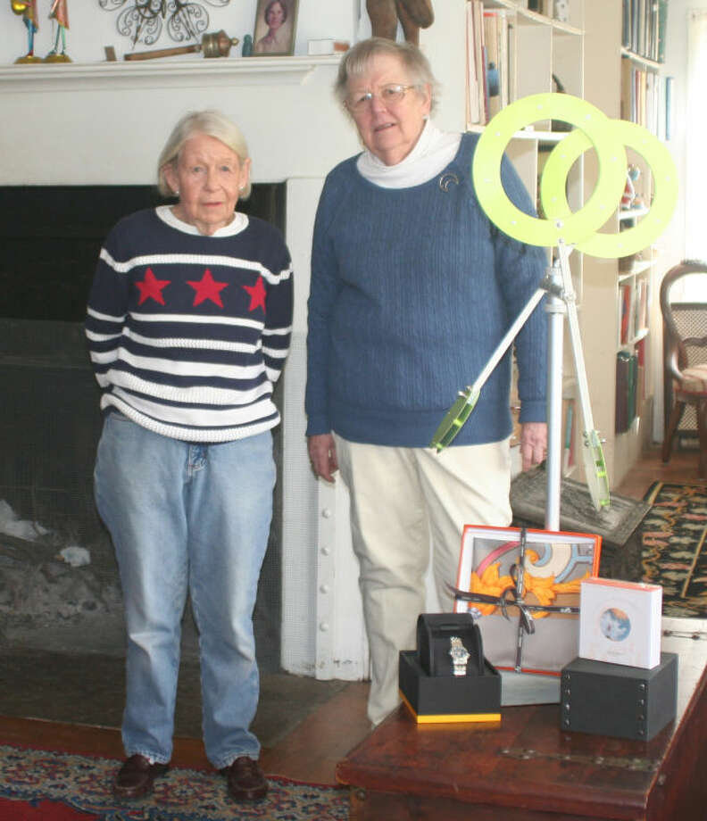 Judy Hitter and Ann Klotz shown with Raffle Prizes