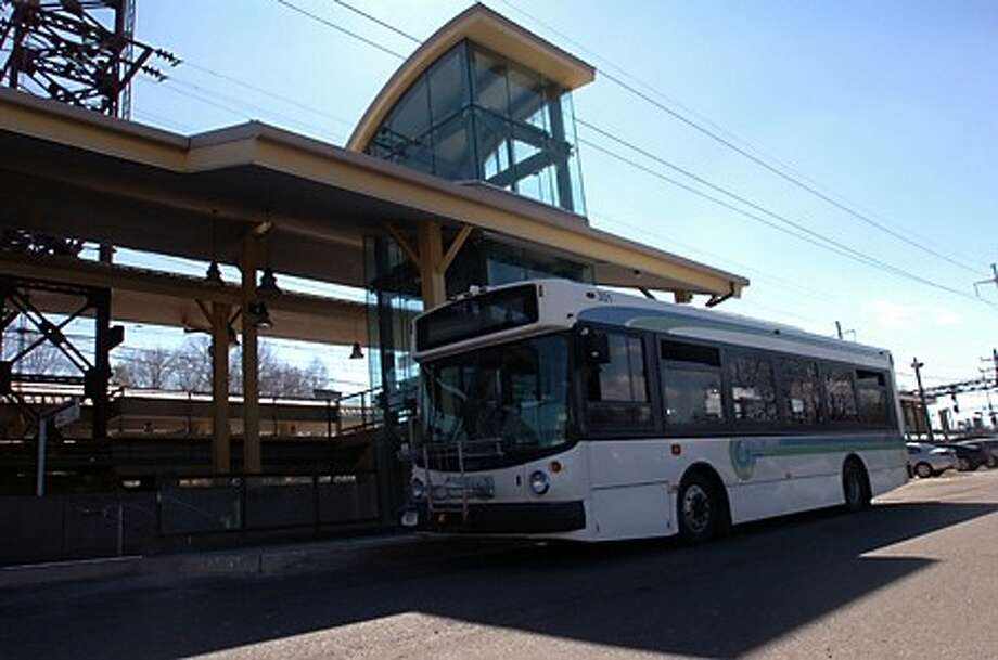 A Wheels bus waits at the Westport train station on the Metro North line. Norwalk Transit District bus service in Westport is threatened by the cutting of local funding. Hour photo / Erik Trautmann