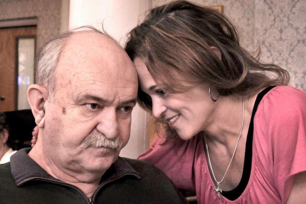 Dawn Belot tenderly talks with her father, Eugene Singer, 72, during a visit to Candlewood Valley Rehabilitation Center in New Milford on Tuesday, April 20, 2010. Singer, a former Danbury assistant fire chief, has Alzheimer's disease.