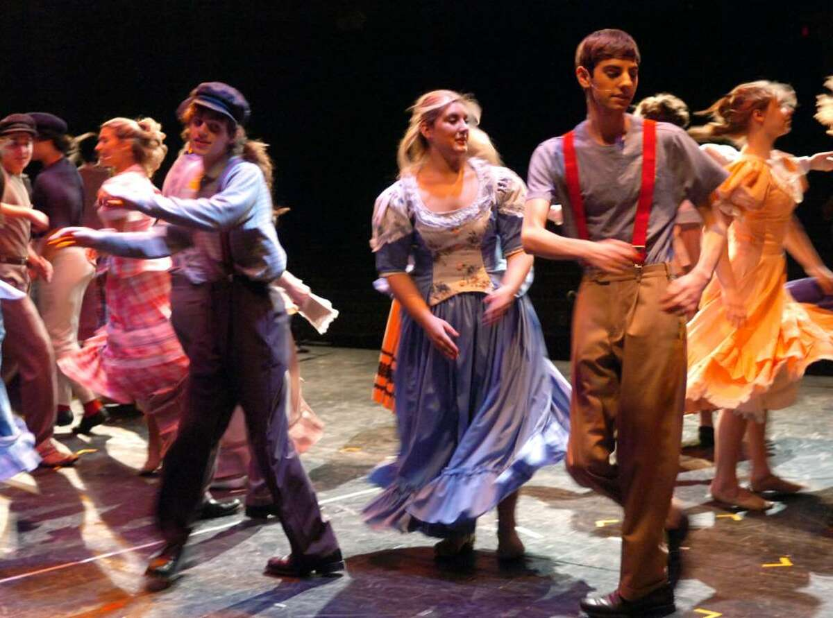 Miiko Valkonen, left, assistant choreographer Jainee DiDonato and Matt Ardditti spin on the stage in Westhill High School's production of Rodgers and Hammerstein's musical