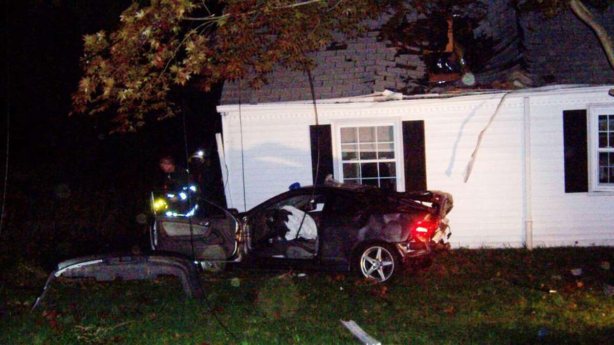 A man was sent to Stamford Hospital with non-life-threatening injuries after losing control of his car and landing on the roof of a Newfield Avenue home. Photo courtesy of the Belltown Volunteer Fire Department.
