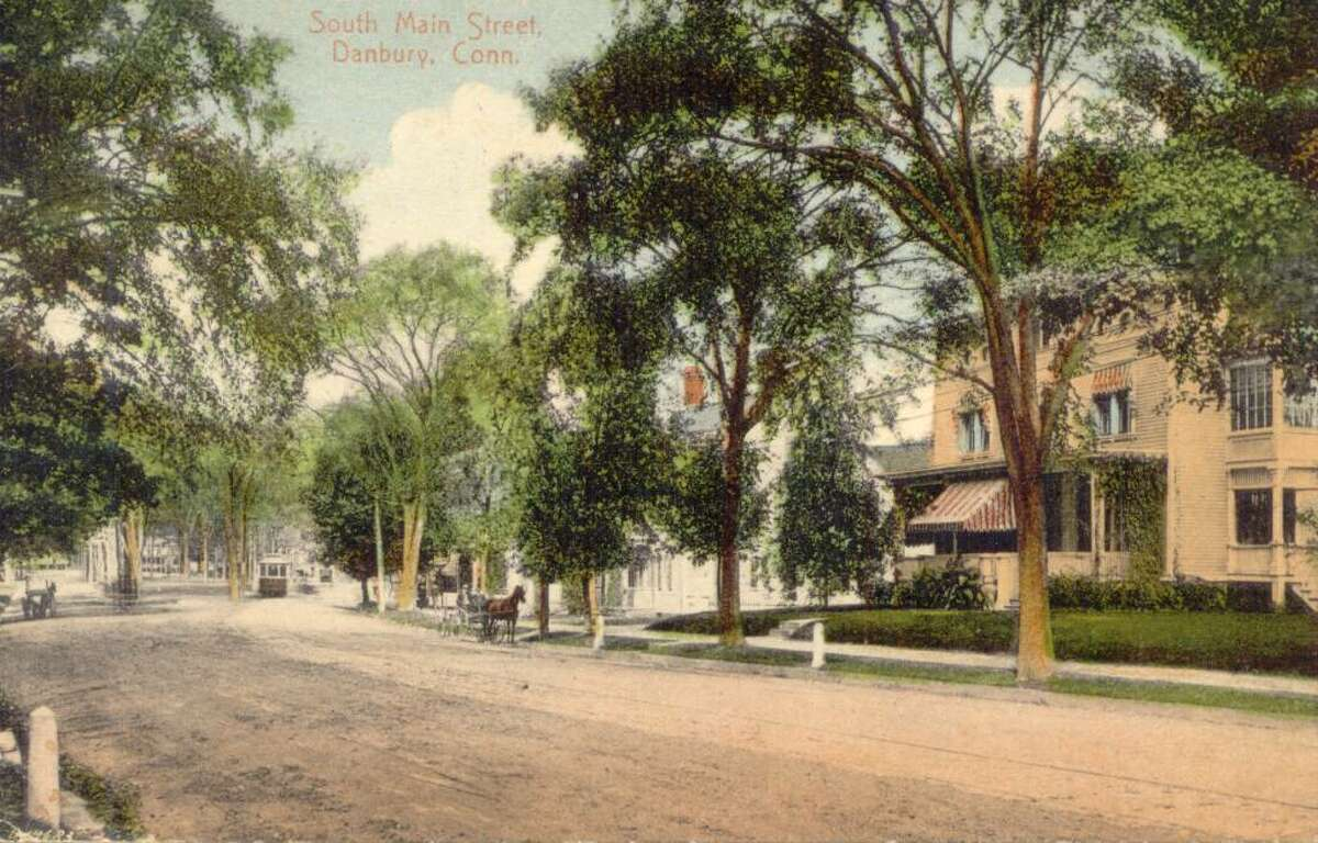 A close look at this view of South Main Street in Danbury reveals both a horse and buggy and a trolley car on the street. The image is from a postcard mailed in 1911, from the collection of George H. Franklin of Brookfield.
