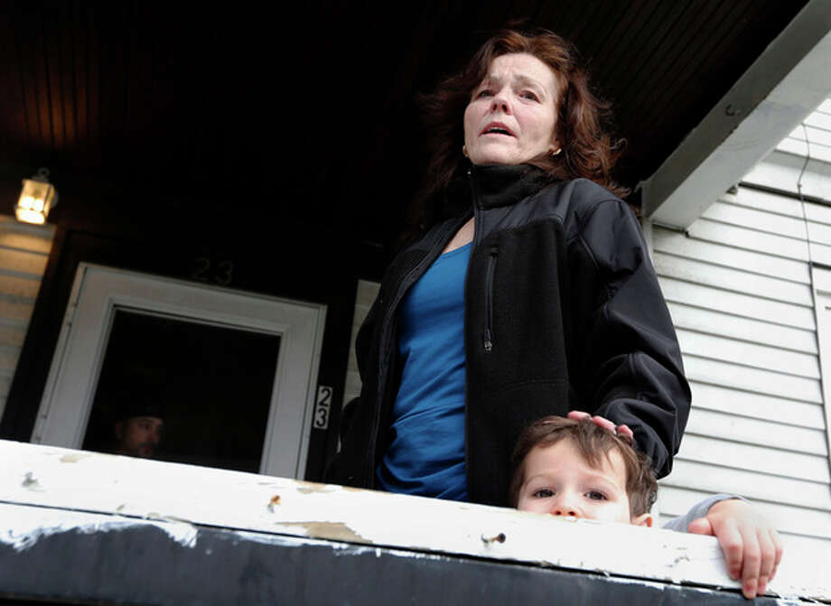 Patty Campbell speaks to reporters outside her home in Medford, Mass., Tuesday, April 16, 2013. Campbell's daughter, Krystle Campbell, was killed in Monday's bombings at the finish line of the Boston Marathon. The boy, lower right, is unidentified. (AP Photo/Michael Dwyer) / AP