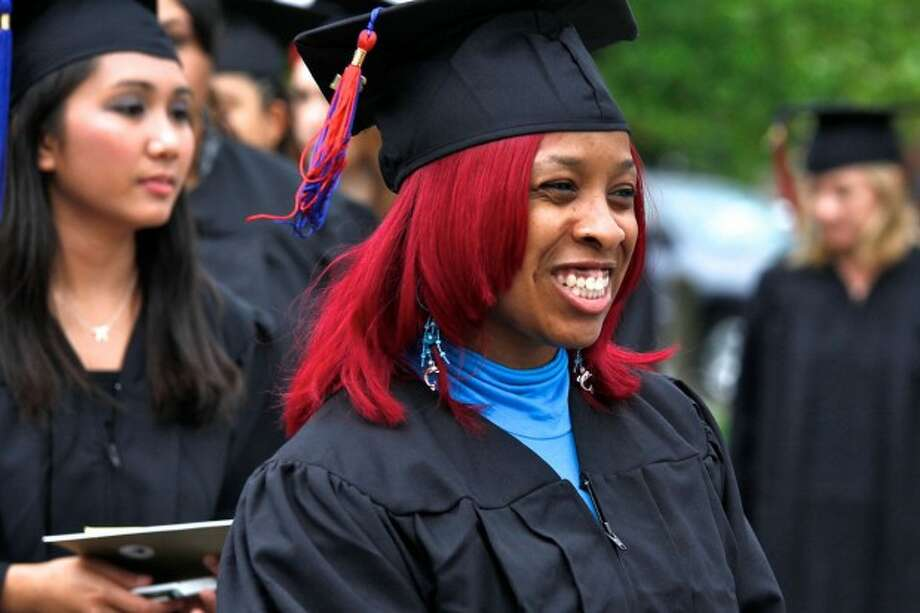 Ebony Bravo smile as she enters Norwalk Community College''s 50th graduation ceremony held Thursday evening. Hour Photo / Danielle Robinson