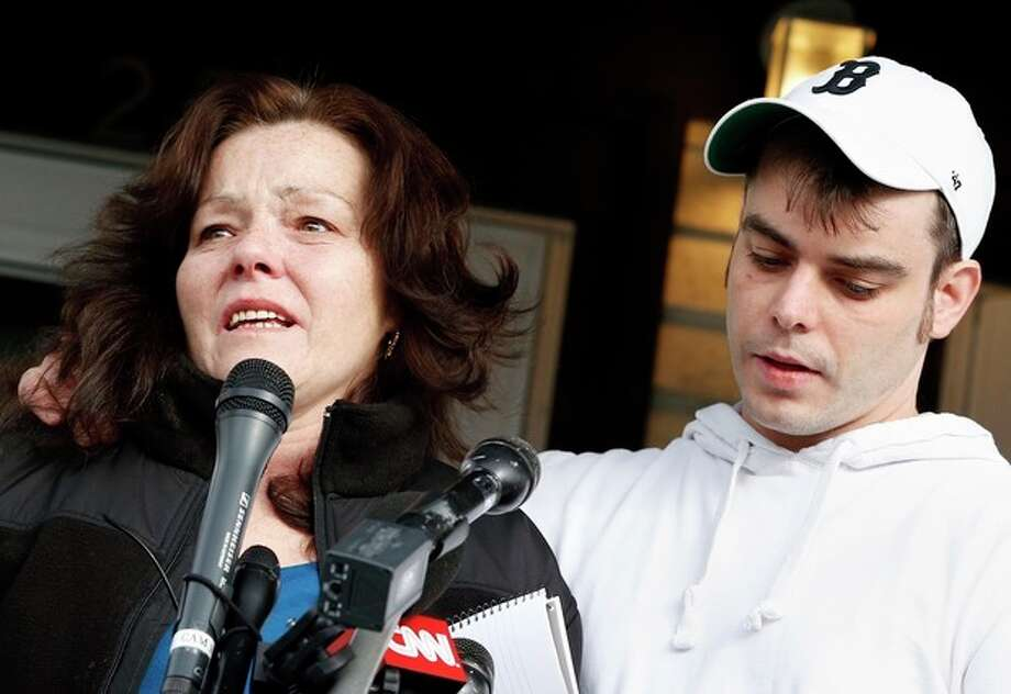 With her son Billy standing beside her, Patty Campbell, left, makes a statement to reporters outside her home in Medford, Mass., Tuesday, April 16, 2013. Campbell's daughter Krystle was killed in Monday's bombings at the finish line of the Boston Marathon. (AP Photo/Michael Dwyer) / AP