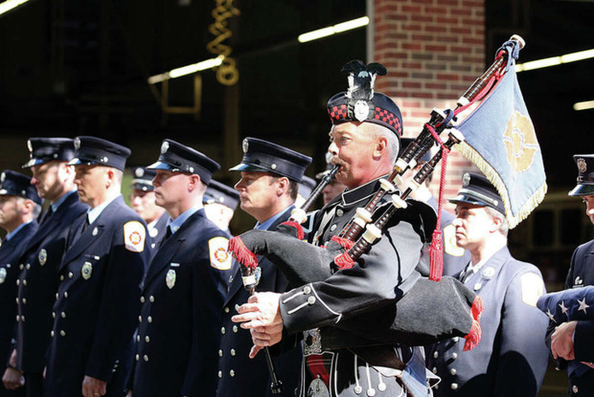 In this 2010 file photo, Ralph Nathanson, Aperatus Supervisor at the Wilton Fire Department, plays the bagpipes in honor of those who lost their lives on Sept. 11, 2001. Photo / Danielle Robinson