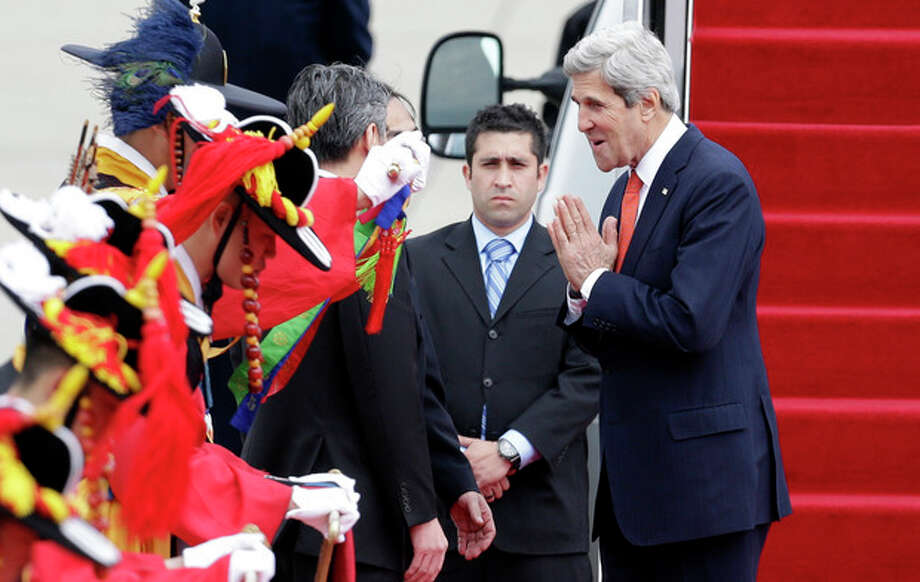 U.S. Secretary of State John Kerry, right, greets upon his arrival at Seoul military airport in Seongnam, South Korea, Friday, April 12, 2013. Kerry is traveling directly into a region bracing for a possible North Korean missile test and risking that his presence alone could spur Pyongyang into another headline-seeking provocation. (AP Photo/Lee Jin-man) / AP