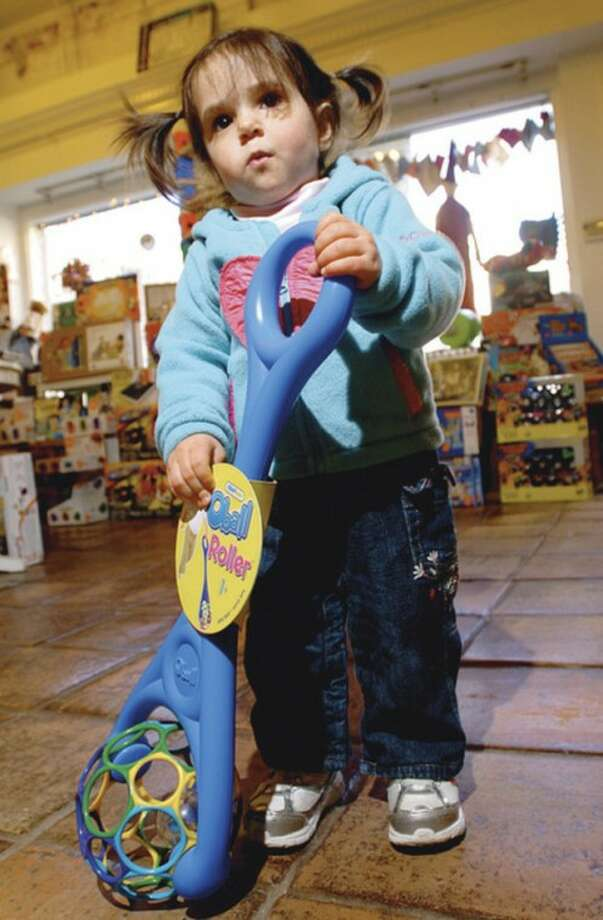 Hour photos / Erik Trautmann 2-year-old Sophie Rossen picks out a popular item at Age of Reason, in Westport, which was named Best Toy Store by Connecticut Magazine.