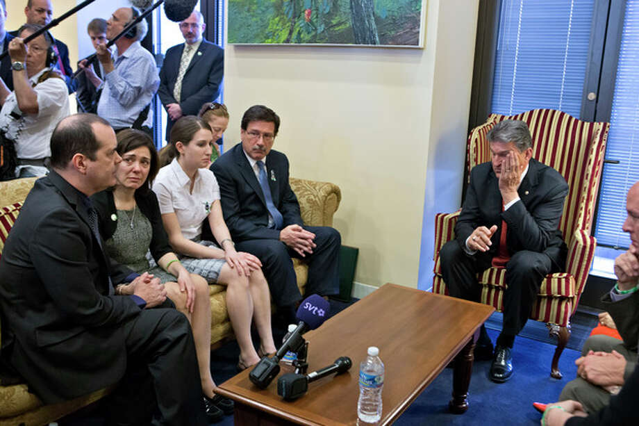Sen. Joe Manchin, D-W.Va., seated right, meets in his office with families of victims of the Sandy Hook Elementary School shooting in Newtown, Conn., on the day he announced that they have reached reached a bipartisan deal on expanding background checks to more gun buyers, on Capitol Hill in Washington, Wednesday, April 10, 2013. Seated on sofa from left are David and Francine Wheeler, who lost their six-year-old son Ben in the shooting, Katy Sherlach and her father Bill Sherlach, whose wife Mary Sherlach was killed. At far right is Mark Barden, father of victim Daniel Barden. (AP Photo/J. Scott Applewhite) (AP Photo/J. Scott Applewhite) / AP