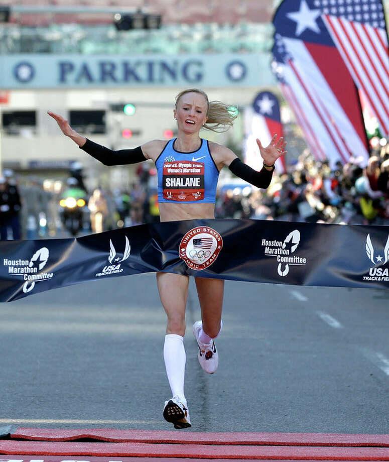 FILE - In this Jan. 14, 2012, file photo, Shalane Flanagan reacts as she crosses the finish line to win the U.S. Olympic Trials women's marathon in Houston. Flanagan grew up in nearby Marblehead, Mass., watching her parents run in the Boston Marathon. When she heads to the starting line on Monday, she'll be the best chance at an American winner, the first since 1985. (AP Photo/David J. Phillip, File) / AP