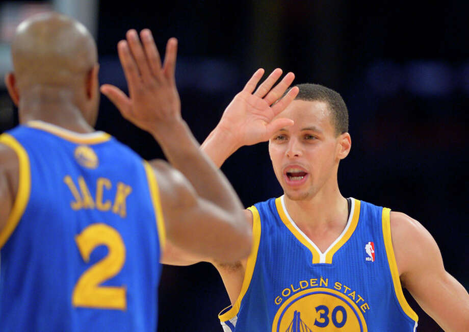 Golden State Warriors guard Stephen Curry, right, is congratulated by guard Jarrett Jack after hitting a 3-pointer during the first half of their NBA basketball game, Friday, April 12, 2013, in Los Angeles. (AP Photo/Mark J. Terrill) / AP