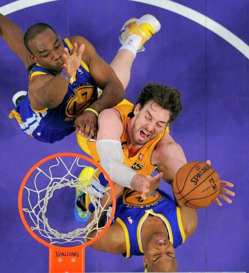 Los Angeles Lakers forward Pau Gasol, center, of Spain, puts up a shot as Golden State Warriors guard Jarrett Jack, below, and forward Carl Landry defend during the first half of their NBA basketball game, Friday, April 12, 2013, in Los Angeles. (AP Photo/Mark J. Terrill) / AP