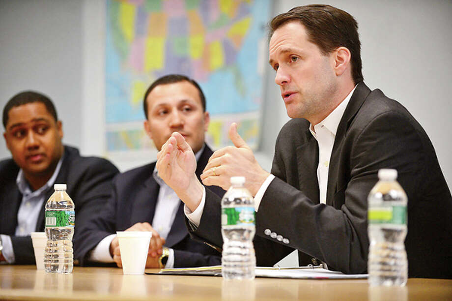 Congressman Jim Himes discusses challenges in Washington D.C. on Immigration Reform during a forum sponsored by Norwalk councilman Warren Pena and joined by councilman David Watts at the South Norwalk Community Center Saturday. Hour photo / Erik Trautmann / (C)2013, The Hour Newspapers, all rights reserved