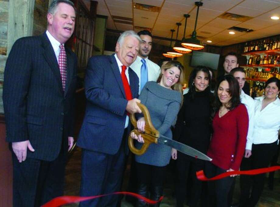 Hour photo/MATTHEW VINCI The Pasta and Pizza Factory opened for business Friday in South Norwalk. Among those at the opening celebration were (left to right): Edward Musante Jr., president of Greater Norwalk Chamber of Commerce; Norwalk Mayor Richard Moccia; co-owner Jacqueline Chrispin; Cristiane Chrispin; and Shereen Girgis.