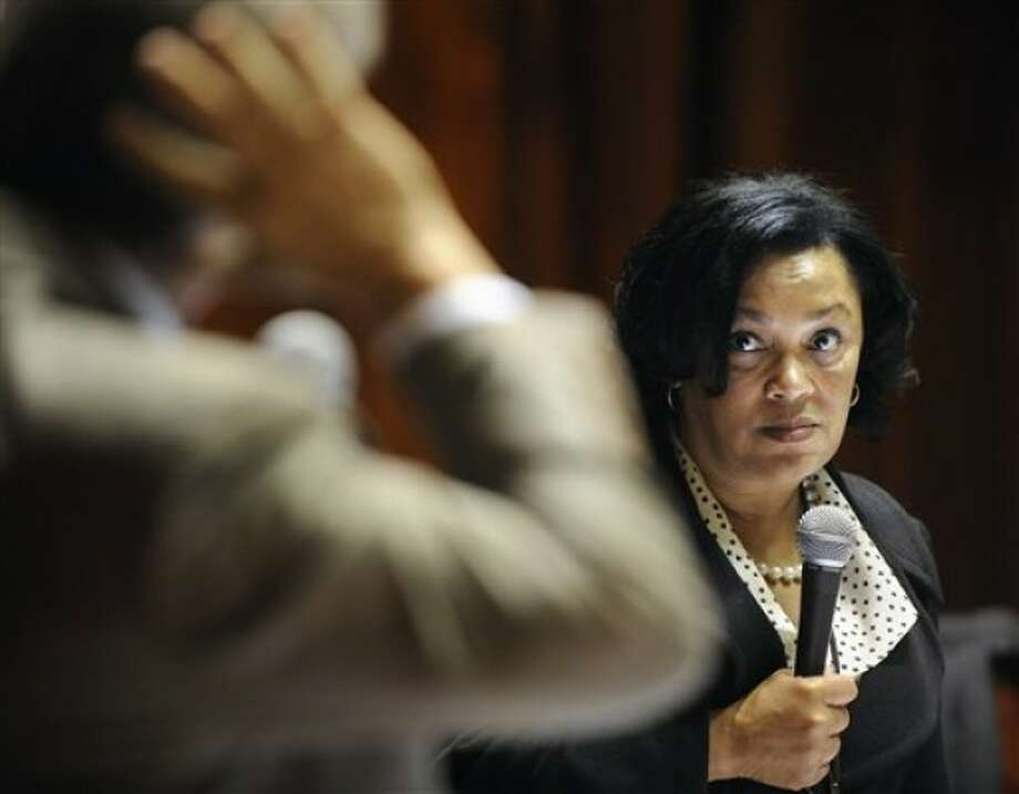 State Sen. Toni Harp D-New Haven, right, listens as Sen. Len Suzio, R-Meriden, left, speak in Senate Chambers during the last day of session at the Capitol in Hartford, Conn., Wednesday, June 8, 2011. (AP Photo/Jessica Hill)