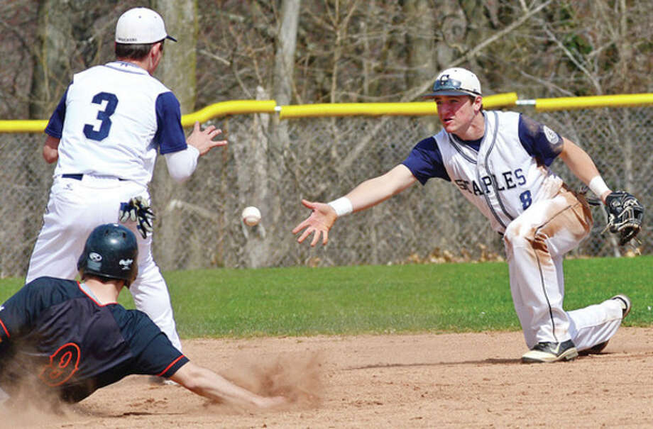 Hour photo/Erik TrautmannStaples shortstop Sam Ellinwood, right, flips the ball to second baseman Nick Vega as Stamford's James Mattimore slides into second base during Tuesday's game in Westport. The Black Knights handed the Wreckers a 7-2 defeat. / (C)2013, The Hour Newspapers, all rights reserved