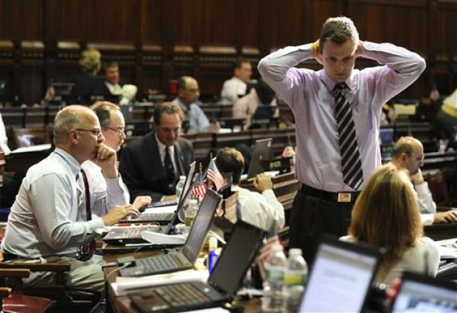 Members of the Connecticut House of Representatives work during the last day of session at the Capitol in Hartford, Conn., Wednesday, June 8, 2011. (AP Photo/Jessica Hill)