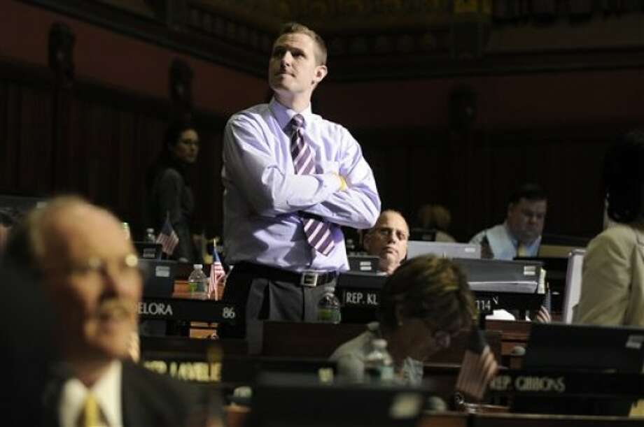 State Rep. Sean Williams R-Watertown listens to a debate in the Connecticut House of Representatives work during the last day of session at the Capitol in Hartford, Conn., Wednesday, June 8, 2011. (AP Photo/Jessica Hill)