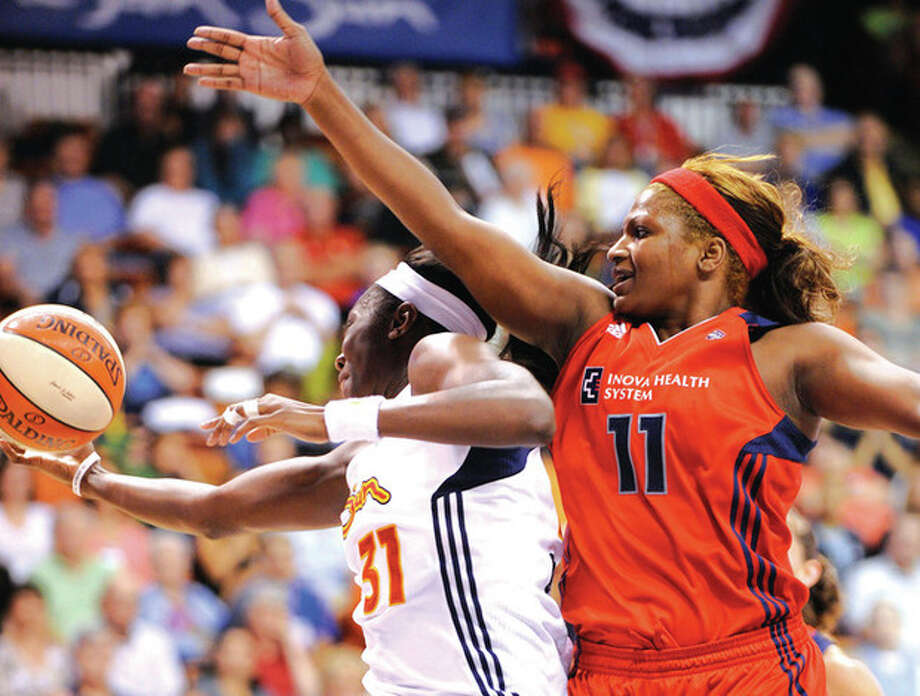 AP photo Tina Charles of the Connecticut Sun, left, and Washington Mystics' DeMya Walker fight for a rebound during the second half of Saturday night's game at Mohegan Sun Arena. Charles scored a team-high 16 points andpulled down seven rebounds in Connecticut's 82-75 victory. / FR153656 AP