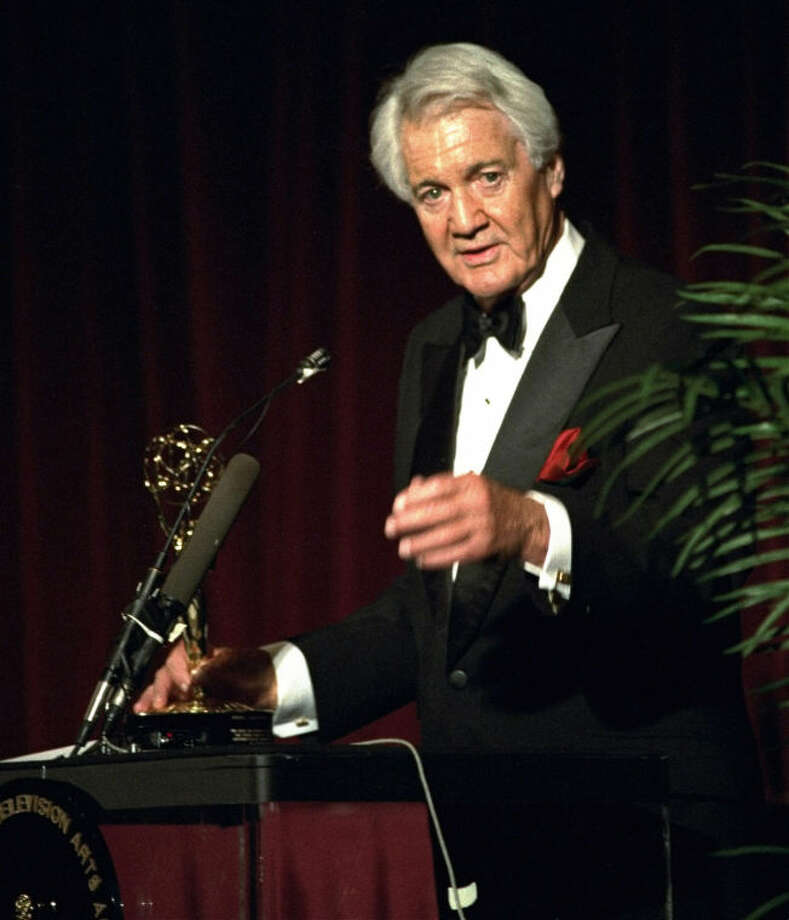 FILE - In this April 19, 1994, file photo, Pat Summerall, completing his 34th and final season with CBS, receives an award for lifetime achievement at the 1994 Sports Emmy Awards in New York. Fox Sports spokesman Dan Bell said Tuesday, April 16, 2013, that Summerall, the NFL player-turned-broadcaster whose deep, resonant voice called games for more than 40 years, has died at the age of 82. (AP Photo/Rob Clark, File)