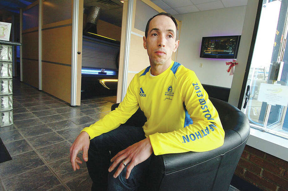 Hour photo/Alex von KleydorffBoston Marathon runner James Whipple at his Norwalk business describes being near the bombings. / 2013 The Hour Newspapers