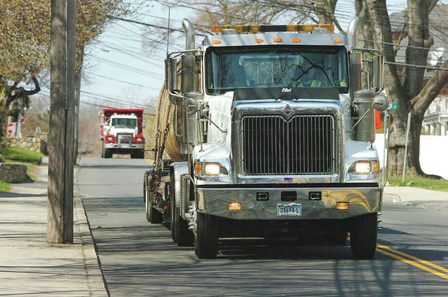 Hour photo / Alex von KleydorffA truck carrying a large underground tank heads down Fairfield Avenue past Golden Hill Street in Norwalk on Tuesday. / 2013 The Hour Newspapers