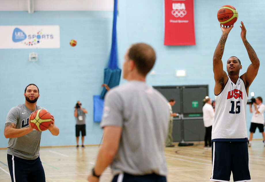 United States' Deron Williams, left, and Carmelo Anthony, right, practice during a men's team basketball training session at the 2012 Summer Olympics, Saturday, July 28, 2012, in London. (AP Photo/Jae C. Hong) / AP