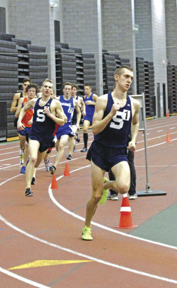 Henry Wynneof Staples takes the lead during one of his races at the FCIAC championship meet at the Floyd Little Athletic Center in New Haven. The All-Area boys indoor track MVP won the 1,000 at the New Englands and won the mile at the New Balance Nationals.Hour Photo / Danielle Robinson