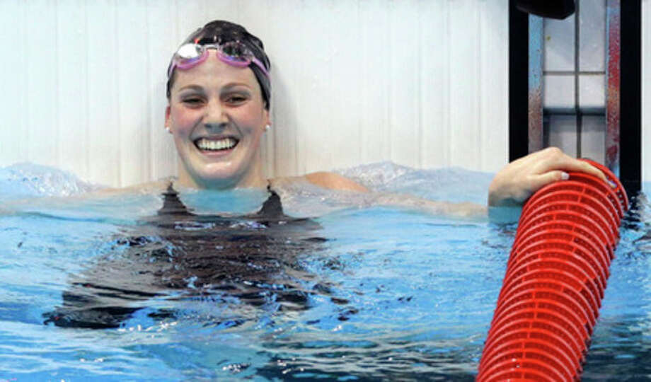 United States' Missy Franklin reacts to her gold nedal win in the women's 100-meter backstroke swimming final at the Aquatics Centre in the Olympic Park during the 2012 Summer Olympics in London, Monday, July 30, 2012. (AP Photo/Lee Jin-man) / AP
