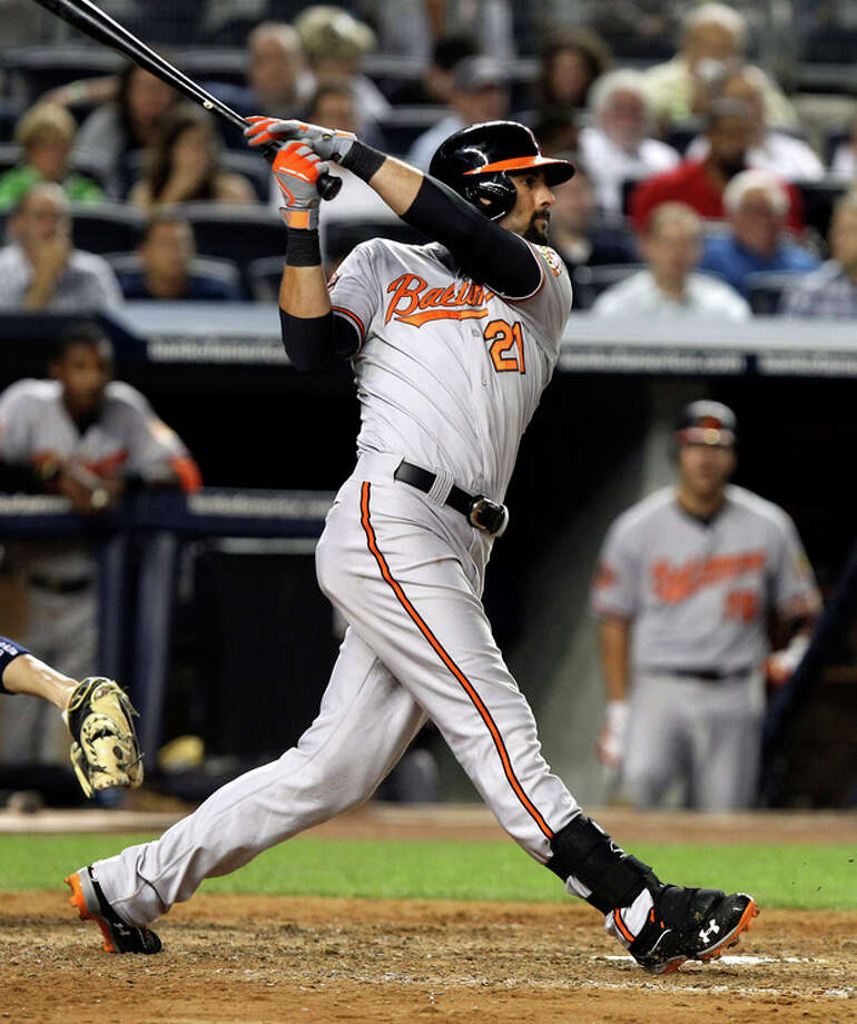 Baltimore Orioles' Nick Markakis hits an RBI double during the seventh inning of a baseball game against the New York Yankees, Monday, July 30, 2012, at Yankee Stadium in New York. (AP Photo/Seth Wenig) / AP