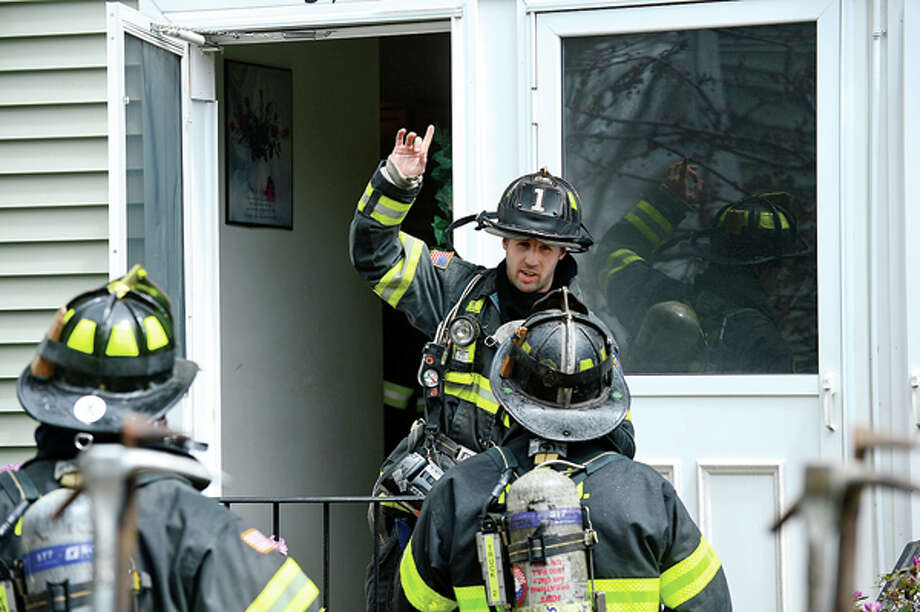 Norwalk firefighters respond to the scene of an apartment fire at 100 San Vincenzo Place Tuesday. Hour photo / Erik Trautmann / AP