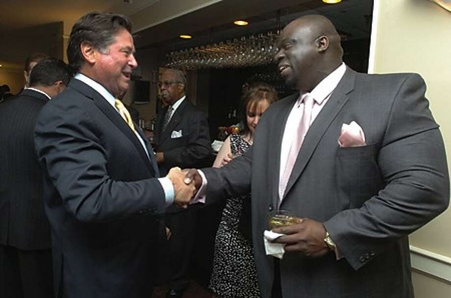 Stew Leonard greets Bill Okwuosa the new director of the Open Door Shelter Thursday night at the Inn at Longshore in Westport for the annual spring gala. hour photo/matthew vinci