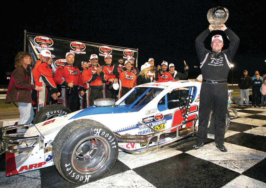 Photo courtesy of NASCAR Ron Silk of Norwalk, driver of the No. 6 T.S. Haulers/ Calverton Tree Farm Chevrolet celebrates winning the Whelen Modified Tour championship in victory lane at Thompson Speedway Sunday. / 2011 Getty Images