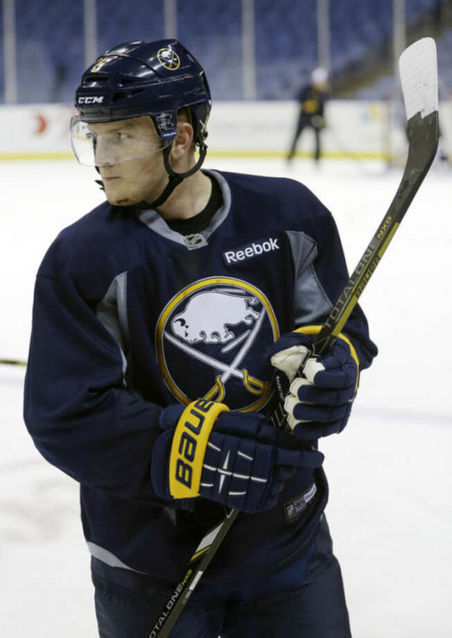 Buffalo Sabres' Chad Ruhwedel looks on during NHL hockey practice in Buffalo, N.Y., Tuesday, April 16, 2013. In the midst of a late-season playoff push, the Buffalo Sabres are expected to take time to reflect on the tragic events that shook the Boston Marathon on Monday. The attack on the marathon is prominent for the Sabres, who were preparing to travel to play the Bruins for a game on Wednesday. (AP Photo/David Duprey)