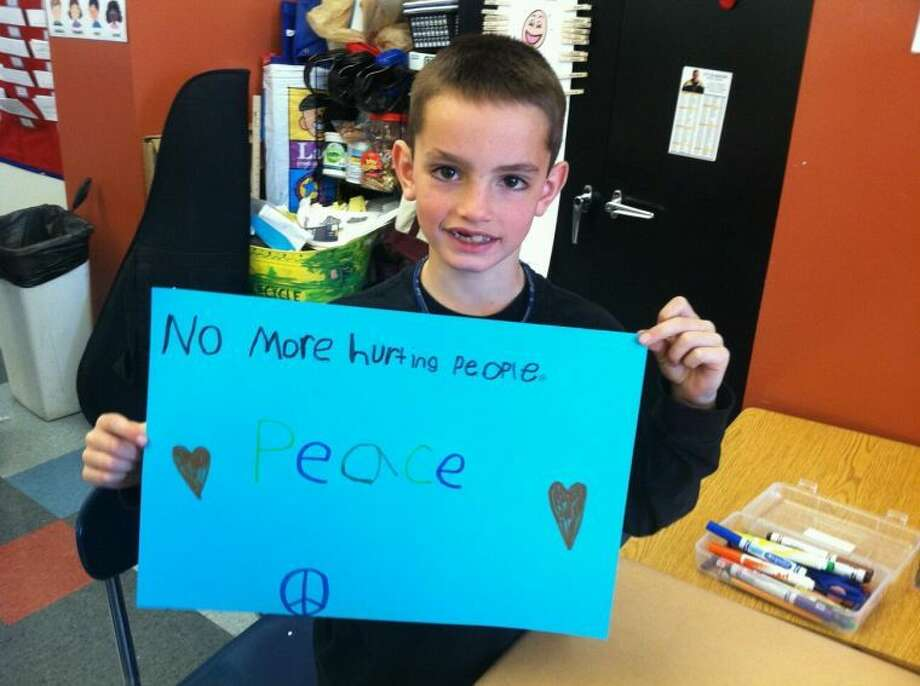 This is Martin, 8. He died in the Boston bombing yesterday. He was at the finish line with his family, waiting for his dad to cross. His mother and little sister were catastrophically injured. He was the student of our dear friend, Rachel Moo. His message resonates powerfully today. My prayer is that we all live by Martin's words, paying tribute to his too-brief, but immeasurably valuable life by following his example.