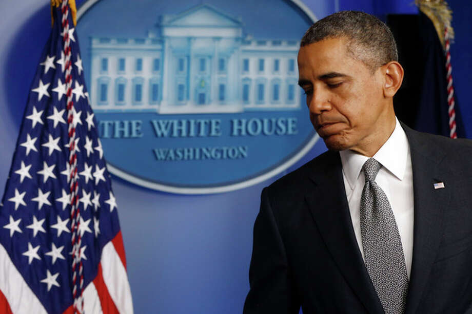 President Barack Obama turns to leave after speaking in the Brady Press Briefing Room of the White House in Washington, Tuesday, April 16, 2013, following the explosions at the Boston Marathon. (AP Photo/Charles Dharapak) / AP