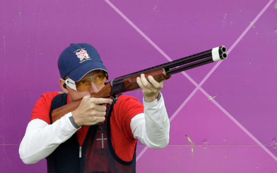 Denmark's Anders Golding shoots during the second day of qualifiers for the men's skeet event at the 2012 Summer Olympics, Tuesday, July 31, 2012, in London. (AP Photo/Rebecca Blackwell) / AP