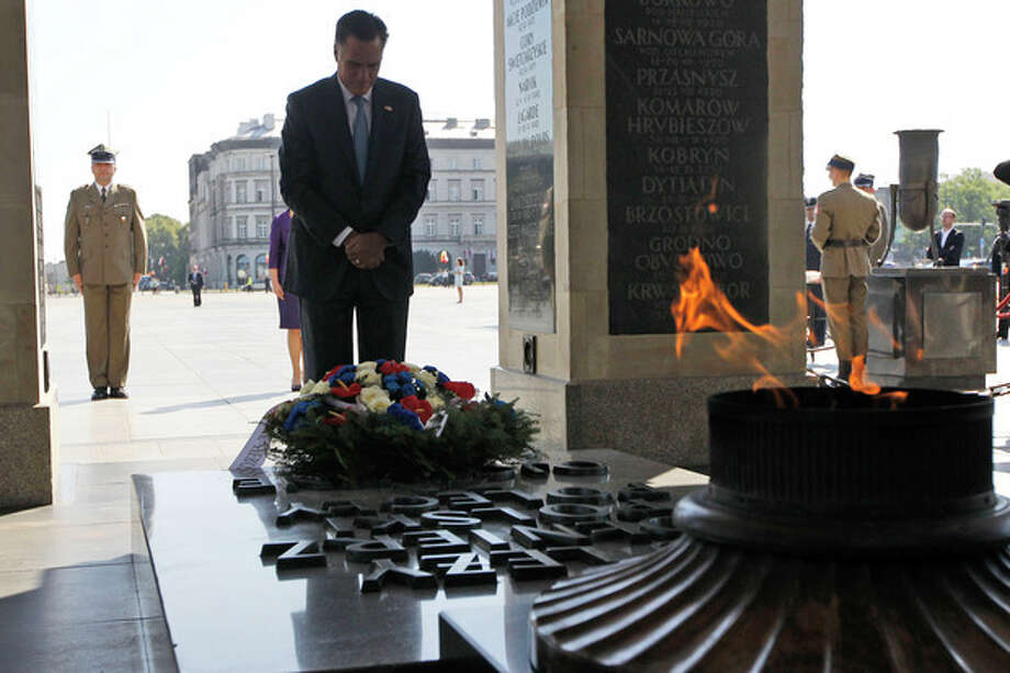 Republican presidential candidate and former Massachusetts Gov. Mitt Romney visits the Tomb of the Unknown Soldier in Warsaw, Poland, Tuesday, July 31, 2012. (AP Photo/Charles Dharapak) / AP