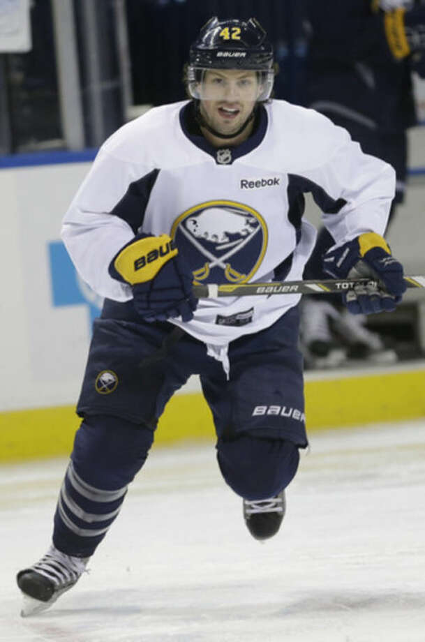 Buffalo Sabres' Nathan Gerbe skates during NHL hockey practice in Buffalo, N.Y., Tuesday, April 16, 2013. In the midst of a late-season playoff push, the Buffalo Sabres are expected to take time to reflect on the tragic events that shook the Boston Marathon on Monday. The attack on the marathon is prominent for the Sabres, who were preparing to travel to play the Bruins for a game on Wednesday. (AP Photo/David Duprey)